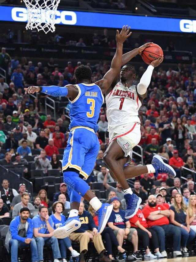 Mar 9, 2018; Las Vegas, NV, USA; Arizona Wildcats guard Rawle Alkins (1) shoots against the defense of UCLA Bruins guard Aaron Holiday (3) during a Pac-12 Tournament semi-final match at T-Mobile Arena. Mandatory Credit: Stephen R. Sylvanie-USA TODAY Sports