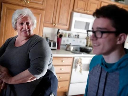 Ellie Hilton talks with her grandson Clark Hutcherson,