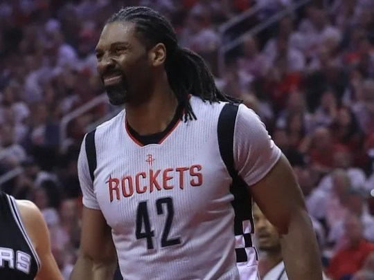 Nene Hilario reacts after he was charged with a foul
