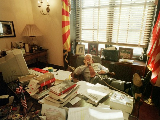 John McCain, R-Ariz., kicks back in his chair March 23, 2001, and makes a phone call while working in his Capitol Hill office in Washington during the Senate debate of the McCain-Finegold campaign-finance reform bill.