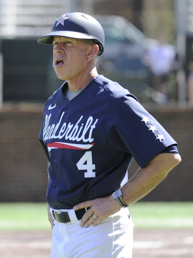 Vandy's coach Tim Corbin looks at the scoreboard during a game against Ole Miss  at Hawkins Field on  April 11,2015.