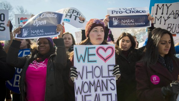 Abortion rights activists rally as the Supreme Court hears Whole Woman's Health v. Cole, the controversial Texas case that sought to limit access to abortions. The law was struck down.