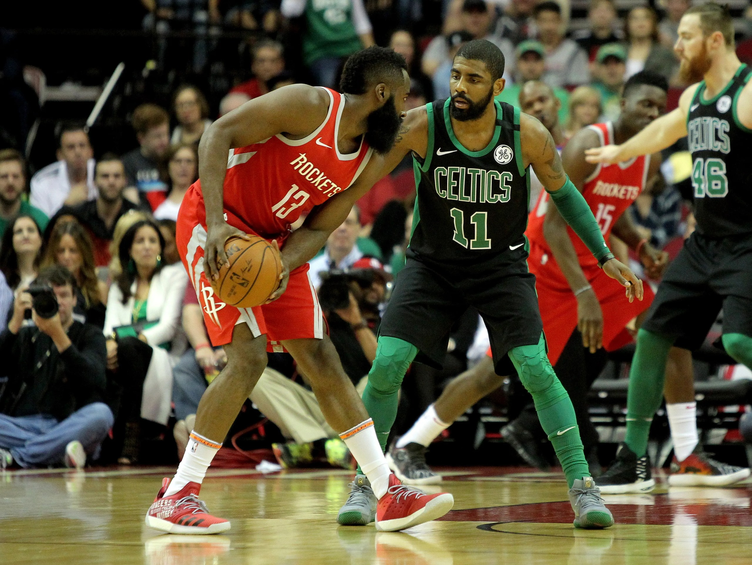 Houston Rockets guard James Harden (13) handles the