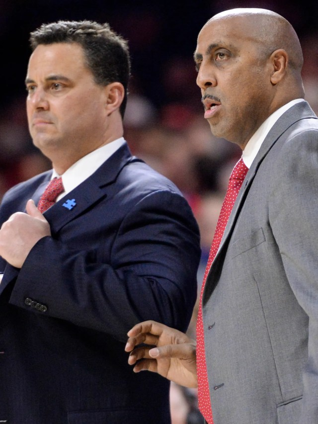 Feb 10, 2018; Tucson, AZ, USA; Arizona Wildcats head coach Sean Miller (left) and associate head coach Lorenzo Romar watch from the sideline during the first half against the Southern California Trojans at McKale Center. Mandatory Credit: Casey Sapio-USA TODAY Sports