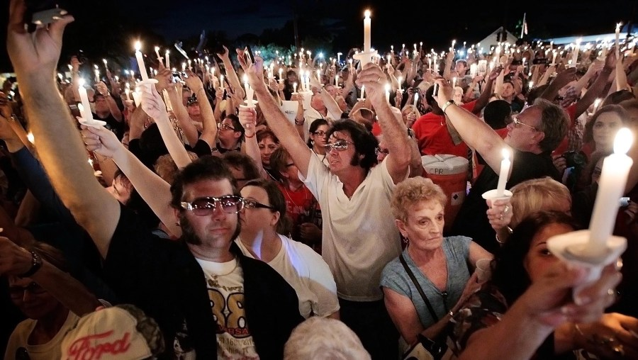 Elvis fans gather in front of Graceland for a vigil to mark the 38th anniversary of the death of Elvis Presley on Aug. 15, 2015. Priscilla Presley and Elvis' daughter, Lisa Marie Presley, participated in the vigil.
