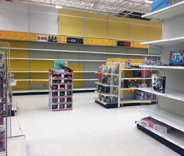 Empty Shelves And Sales Items Are All That Remain In