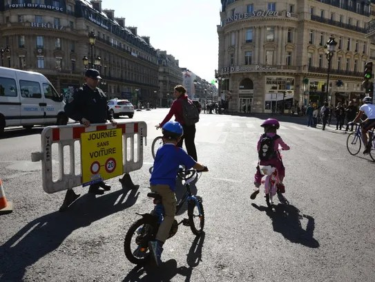 "The sign reads, ""A day without cars,"" as Parisians"