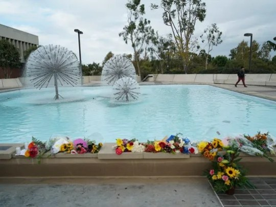 Students placed flowers at a fountain on the campus