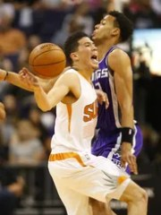 Phoenix Suns guard Devin Booker (1) is fouled by Sacramento