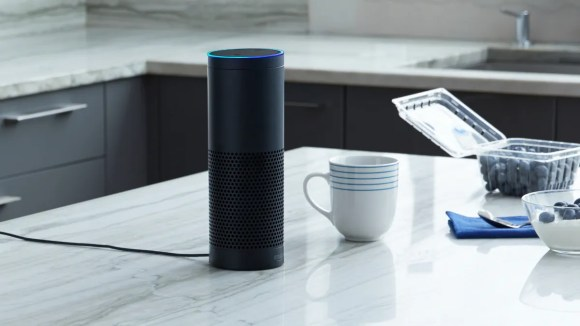 An Amazon Echo sits on a kitchen counter.