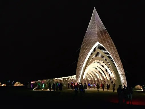 Burning Man participants visit the site's temple, which