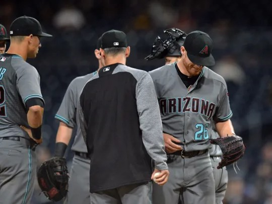 Starter Shelby Miller (26) smiles as he is taken out