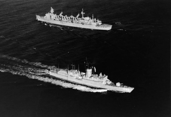 The USS Paul, foreground, passes the USS Detroit off Newport, Rhode Island in 1972.