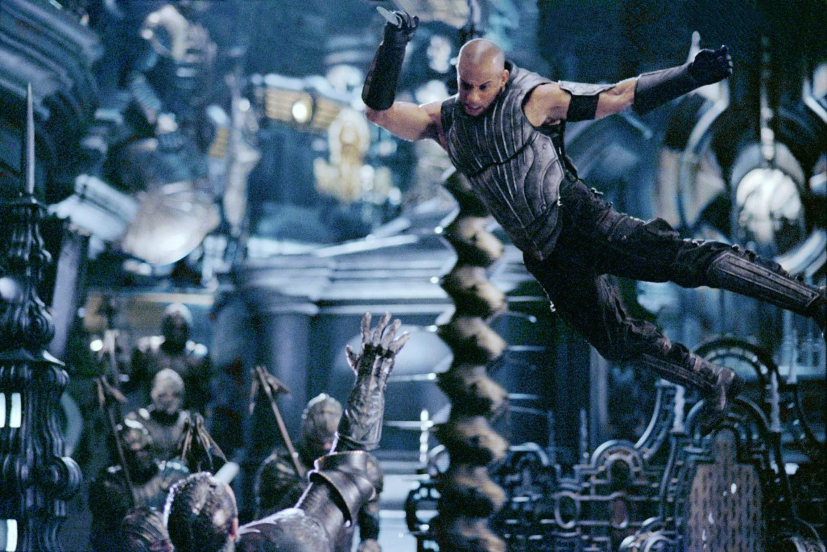 """Vin Diesel takes flight in a scene from the motion picture """"The Chronicles of Riddick."""""""