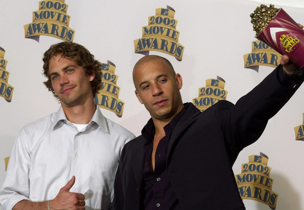 """He and Paul Walker pose for photographers after they won the award for best on-screen team for their work in """"Fast & Furious"""" at the 2002 MTV Movie Awards."""