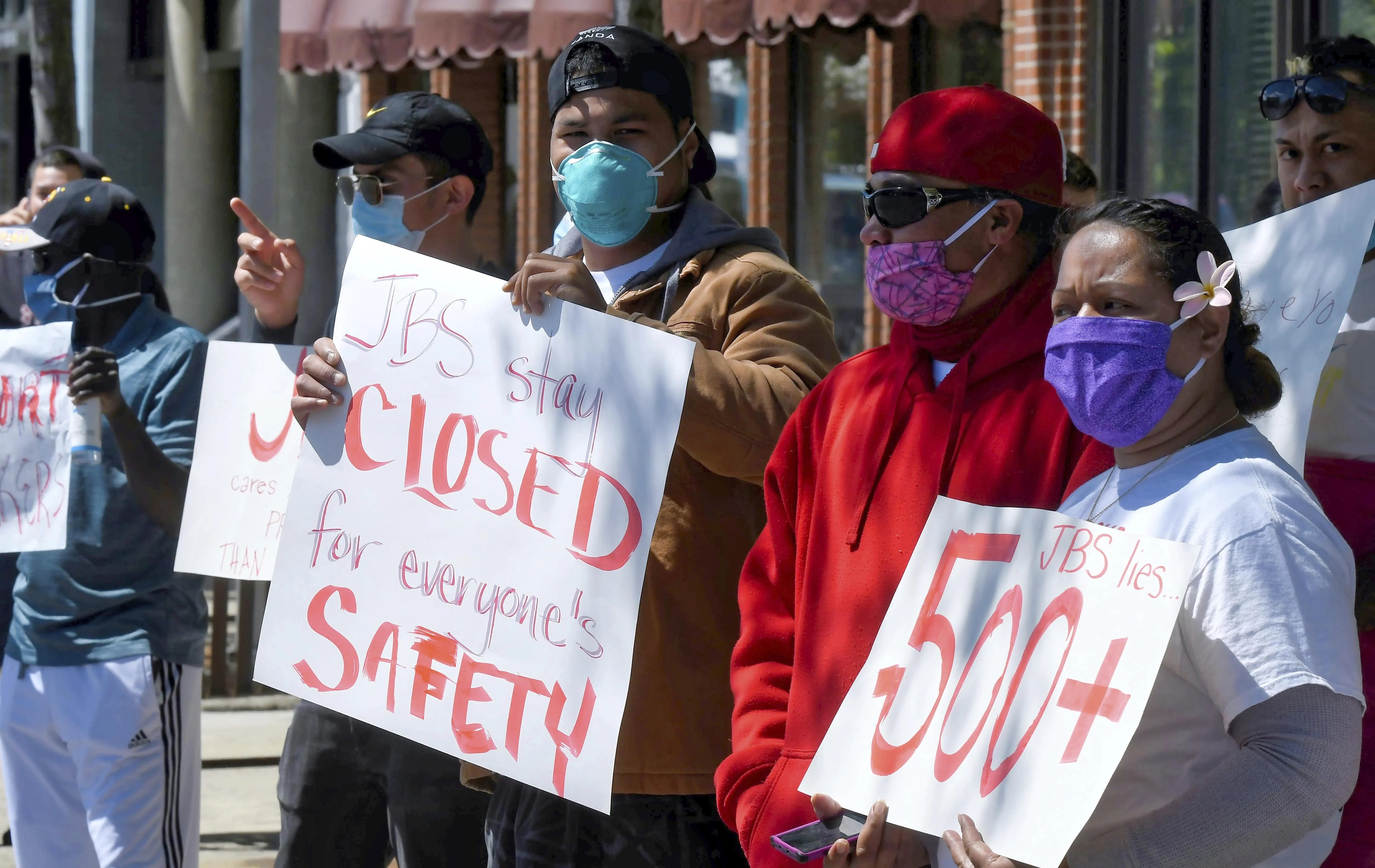 Workers at the JBS USA meatpacking plant protest in Logan, Utah, the company's handling of a coronavirus outbreak that has resulted in nearly 300 confirmed cases.