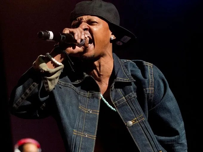 In this Feb. 23, 2013, photo Chris Kelly of the 1990s kid rap duo Kris Kross performs on stage at the Fox Theatre in Atlanta during the So So Def 20th Anniversary Concert. Kelly died of an apparent drug overdose at his home on Wednesday, authorities said.