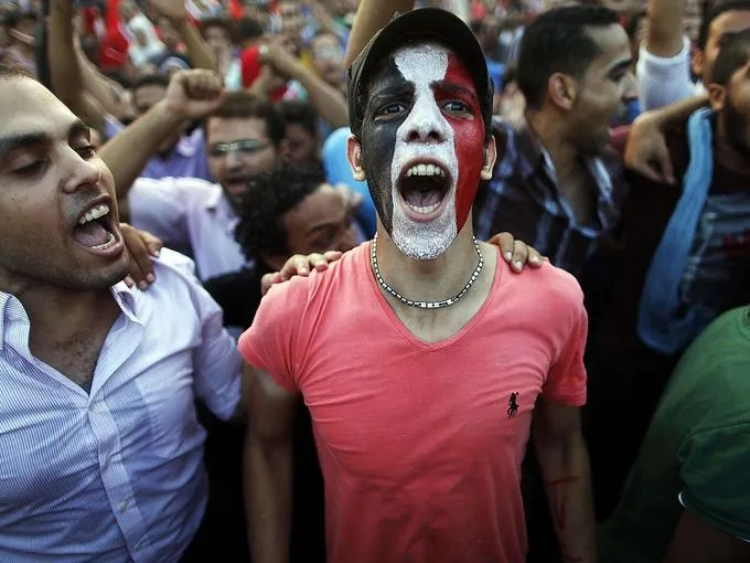 Protesters shout slogans against Morsi and the Muslim Brotherhood near the presidential palace.