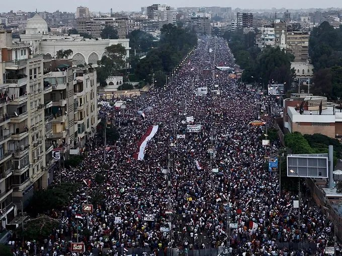 Opponents of Egyptian President Mohammed Morsi protest outside the presidential palace in Cairo.