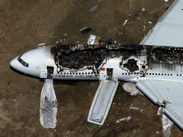 A Boeing 777 airplane lies burned on the runway after it crash landed at San Francisco International Airport July 6, 2013 in San Francisco. The Asiana Airlines passenger aircraft coming from Seoul, South Korea.