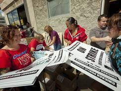 Members of the Chicago Teachers Union distribute strike signs on  Sept. 8 in Chicago.