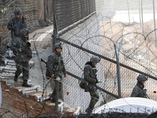 South Korean soldiers patrol along a barbed-wire fence near the border village of Panmunjom in Paju, South Korea, on March 31. (Photo: Ahn Young-joon, AP)
