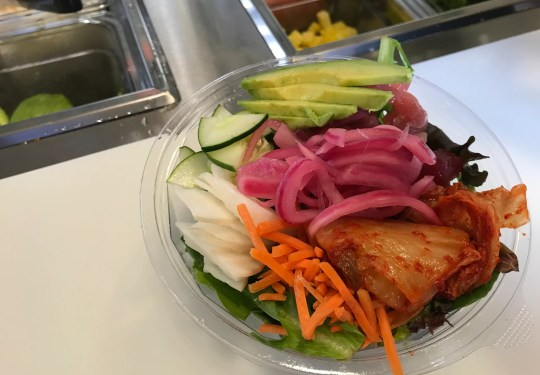 Tuna, daikon, avocado, carrots, kimchi, cucumbers on citrus-dressed greens at Poké Guru. The build-your-own poké bowl stand opened July 23, 2018, at Indianapolis City Market in Downtown Indy.