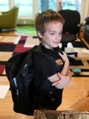 Graham Rockafellow, 6, wears his backpack with the BulletSafe panel inserted at their home in Shelby Township, Mich. on Aug. 21, 2018. The BulletSafe backpack panel is 10 x 14 inches and can be put in a backpack, briefcase or or any other bag.