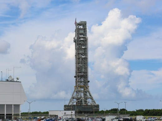 NASA teams, using the historic crawler-transporter, slowly move the mobile launcher from Kennedy Space Center's Vehicle Assembly Building to pad 39B on Thursday, Aug. 30, 2018. The mobile launcher will eventually host the agency's Space Launch System rocket.