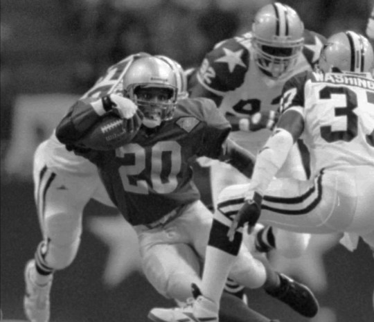 Detroit Lions runningback Barry Sanders (20) looks for a way around Dallas Cowboys James Washington (37 during the second quarter Monday night, Sept. 19, 1994, in Irving, Texas.