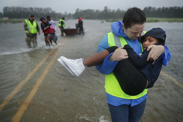 Florence marches into South Carolina, having killed at least 5 people despite dramatic rescues