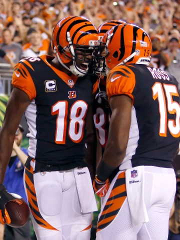 Bengals wide receiver A.J. Green (18) reacts with teammate John Ross after Green scored a touchdown against the Ravens.