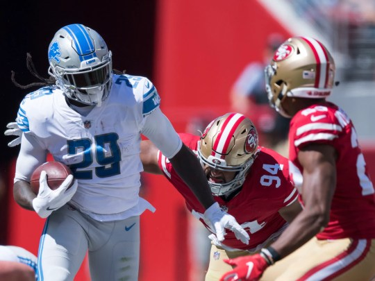 Detroit Lions running back LeGarrette Blount runs against San Francisco 49ers defensive end Solomon Thomas (94) and cornerback Ahkello Witherspoon (23) during the first quarter at Levi's Stadium on Sunday, Sept. 16, 2018.