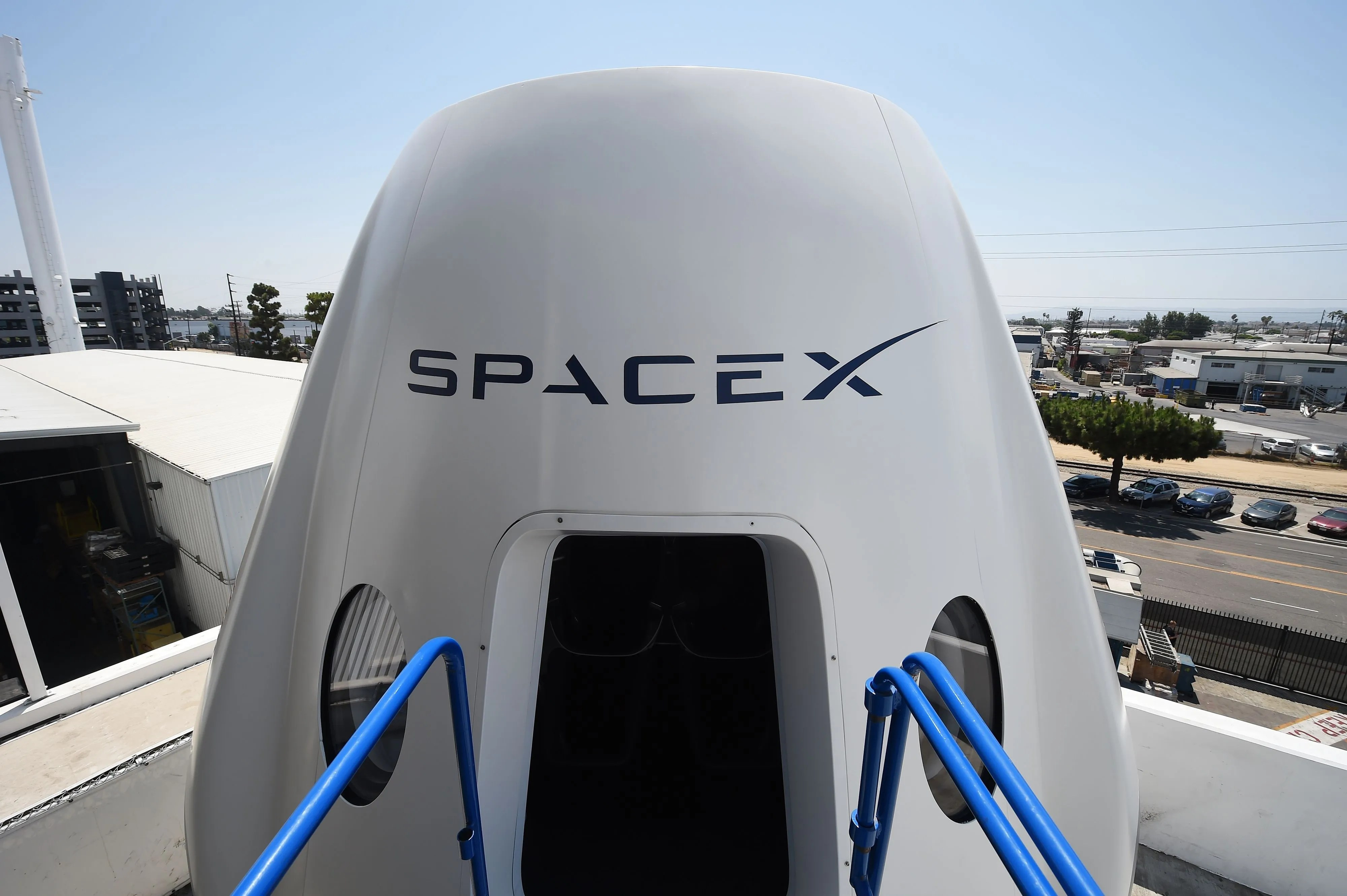 Elon Musk's SpaceX to name first passenger for round-the ...