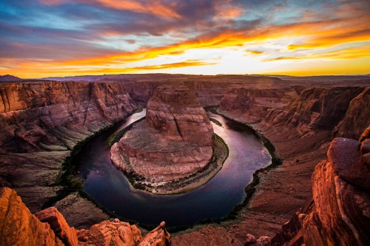 The sun sets over the Colorado River at Horseshoe Bend in the Glen Canyon National Recreational Area near Page.