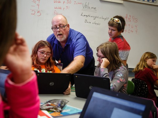 Math and technology teacher Jeff Whyle shows a class of fifth-graders how to create basic code on Wednesday, Oct. 3, 2018 in Jefferson. Whyle came out of retirement to create the curriculum which will open the doors for students to get high paying tech jobs like the ones software consulting company Pillar Technology plans to bring to downtown Jefferson.