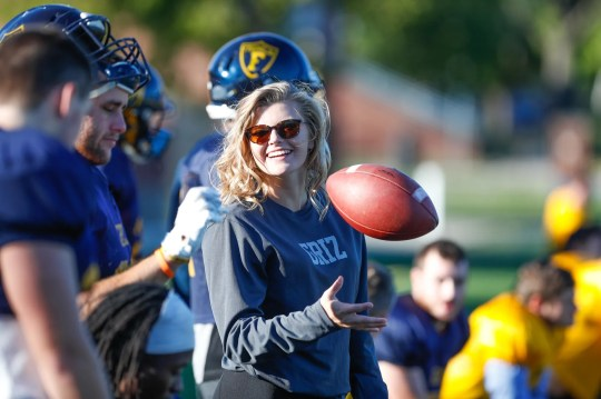 Hope Nelson, a freshman student football coach at Franklin College, and a former football player on the mens team at Indian Creek High School, chats with players during practice at Franklin College on Thursday, October 11, 2018. Nelson, who suffered a childhood eye injury hasn't been held back by blindness in one eye, playing high school football on the mens team as a  defensive back, cheerleading, pole vaulting, and taking years of dance. Nelson plans to try out for the mens team at Franklin in the spring.