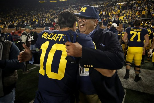 Michigan sporting director Warde Manuel kisses relief quarterback Dylan McCaffrey after the 38-13 victory over Wisconsin October 13, 2018 at Michigan Stadium.
