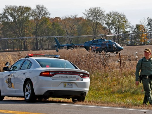 An Indiana State Police helicopter gets ready for takeoff as the scene is investigated near 4600 North IN State Rd. 25 north of Rochester, IN, where a pickup truck hit and killed three young children and critically injured a fourth as the children crossed the street to get on a school bus, Tuesday, Oct. 30, 2018.  The bus was stopped with lights and stop indicators in use.