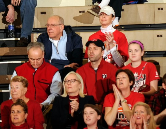 Just regular parents: Syracuse basketball coach Jim Boeheim and his wife Juli Boeheim, top, watch their daughter Jamie play in the state high school championship in March 2018.