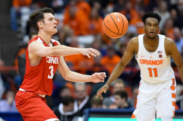 Nov 10, 2017; Syracuse, NY, USA; Cornell Big Red forward Jimmy Boeheim (3) passes the ball as Syracuse Orange forward Oshae Brissett (11) defends during the second half at the Carrier Dome. Mandatory Credit: Rich Barnes-USA TODAY Sports