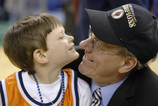 Head coach Jim Boeheim of Syracuse shares a moment with his son James after defeating Kansas 81-78 during the championship game of the NCAA Men's Final Four Tournament on April 7, 2003 at the Louisiana Superdome in New Orleans, Louisiana.