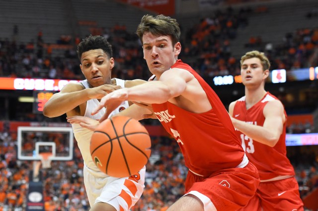 Nov 10, 2017; Syracuse, NY, USA; Cornell Big Red forward Jimmy Boeheim (3) reaches for a loose ball in front of Syracuse Orange forward Matthew Moyer (2) during the first half at the Carrier Dome. Mandatory Credit: Rich Barnes-USA TODAY Sports