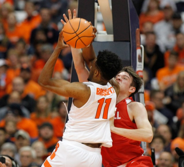 Syracuse's Oshae Brissett, left, shoots under pressure from Cornell's Jimmy Boeheim, right, in the first half of an NCAA college basketball game in Syracuse, N.Y., Friday, Nov. 10, 2017. (AP Photo/Nick Lisi)