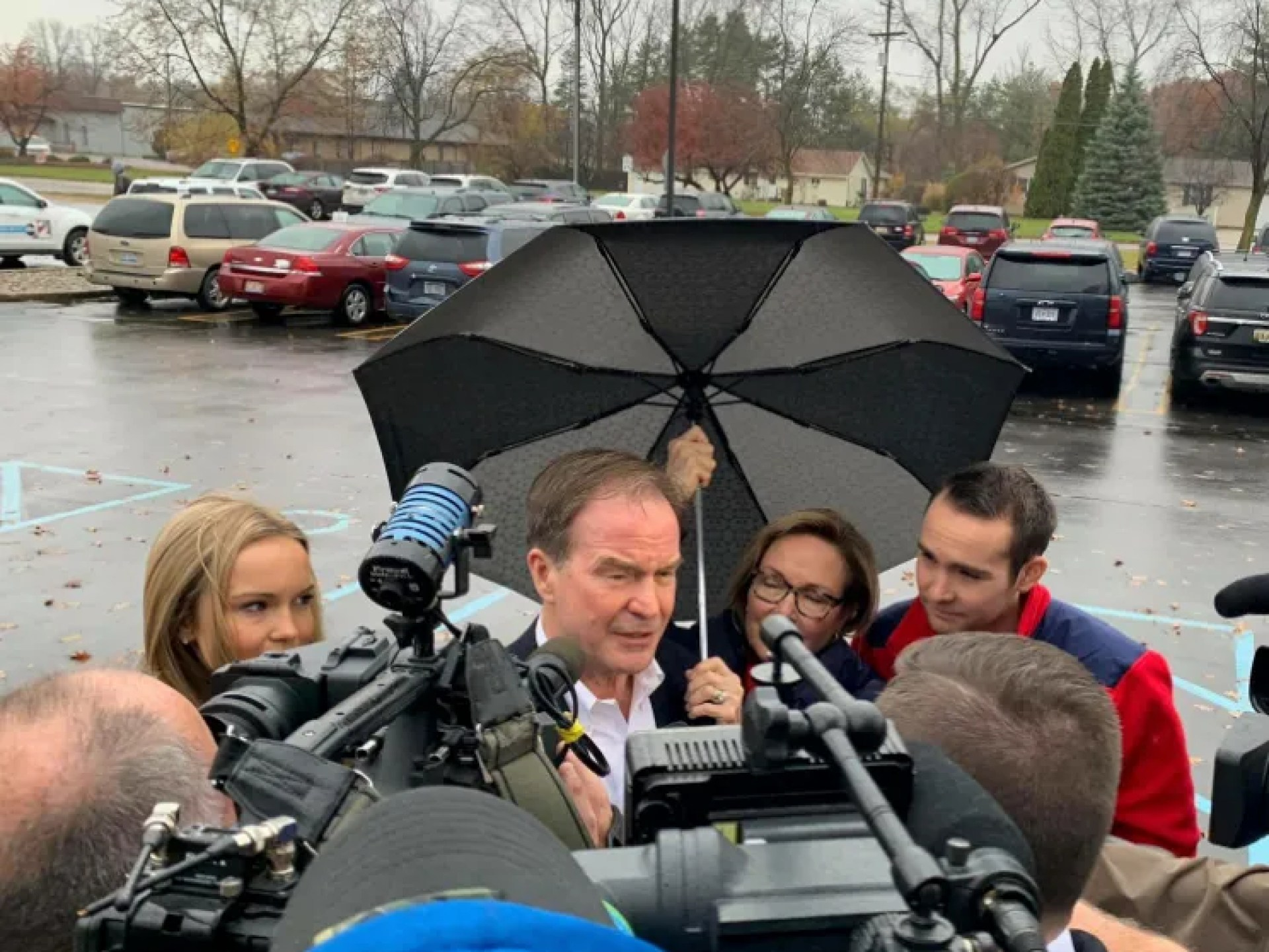 Republican gubernatorial candidate Bill Schuette arrives at his polling station in Midland, Michigan Tuesday surrounded by reporters.
