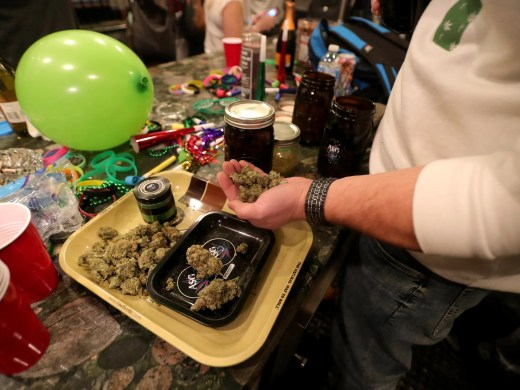 Supporters of Proposal 1 wait as results come in Tuesday, November 6, 2018 in Detroit, Mich.The proposal to legalize marijuana for adult recreational use was leading in early results.