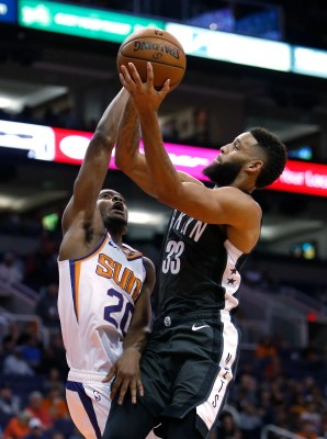 "Brooklyn Nets guard Allen Crabbe (33) rides on Phoenix Suns forward Josh Jackson during the first half during an NBA basketball game Tuesday, November 6, 2018, in Phoenix. (AP Photo / Rick Scuteri) ""data id ="""