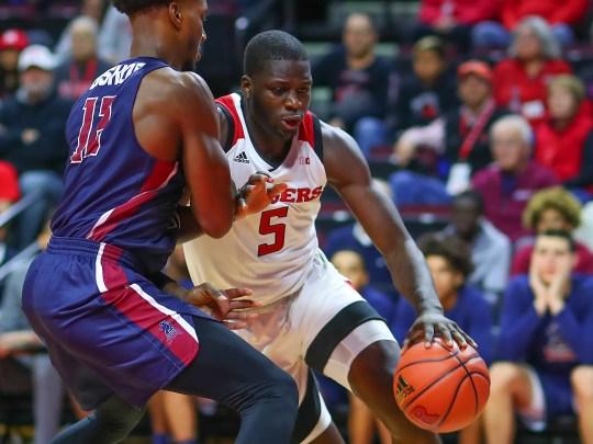 Rutgers - Eugene Omoruyi drives against FDU