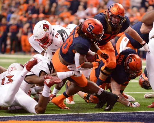 Nov 9, 2018; Syracuse, NY, USA; Syracuse Orange running back Jarveon Howard (28) scores a touchdown against the Louisville Cardinals during the first quarter at the Carrier Dome. Mandatory Credit: Mark Konezny-USA TODAY Sports