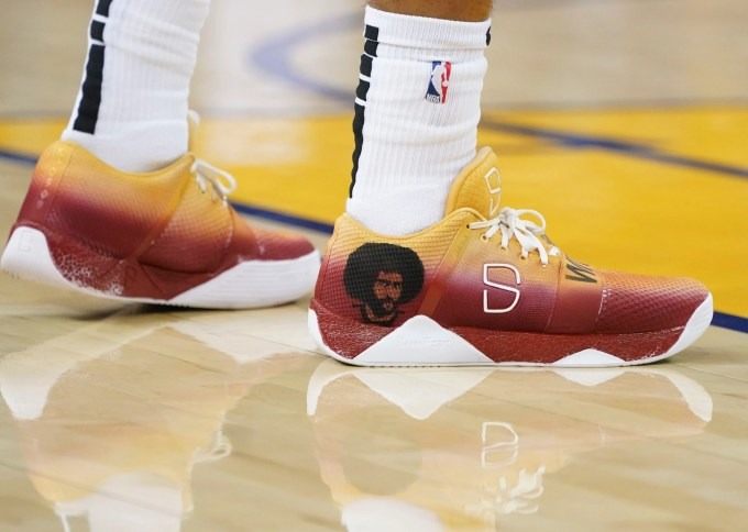 Nov. 10: Nets guard Spencer Dinwiddie supports NFL quarterback Colin Kaepernick at Oracle Arena in Oakland.